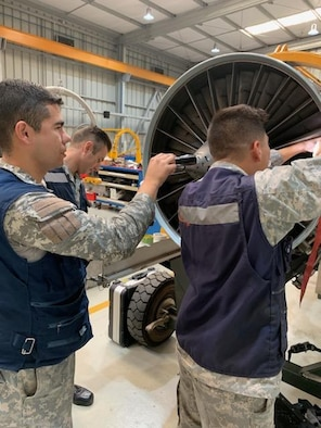 Chilean airmen practice performing blade blending August 26, 2019, at Cerro Moreno Air Base, Chile. U.S. Airmen were on a temopary duty where they ceritified 15 Chilean airmen on how to perform repairs on F100-Pratt and Whitney-W220 jet engine fan blades. (Courtsey photo)