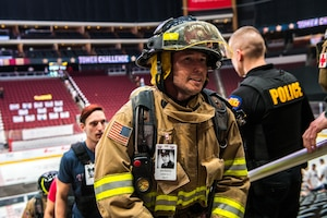 A firefighter from the Casa Grande Fire Department climbs stairs during the 9/11 Tower Challenge Sept. 11, 2019, at the Gila River Arena, Glendale, Ariz.