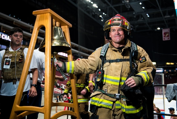 A firefighter from the Glendale Fire Department rings a bell during the 9/11 Tower Challenge Sept. 11, 2019, at the Gila River Arena, Glendale, Ariz.