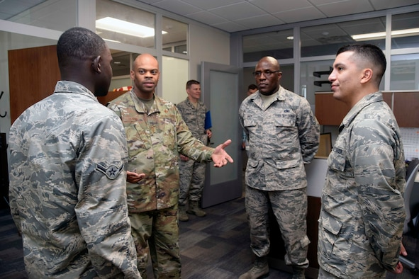 Chief Master Sgt. Travon W. Dennis, Air Force Reserve Command first sergeant (second from left), talks with 433rd Aeromedical Staging Squadron Reserve Citizen Airmen, Airman Momar N. Ndiaye, health services management apprentice (left), Master Sgt. Stewart G. Smith, first sergeant, and Airman Basic Matthew Romero, health services management apprentice, Sept. 7, 2019 at Joint Base San Antonio-Lackland, Texas.