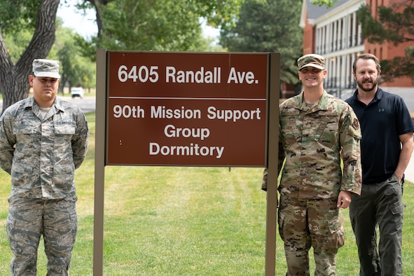 Senior Airman Wil Yau, 90th Communications Squadron client systems technician and originally from Kissimmee, Fla., Staff Sgt. Kenneth Rosenquist, 90th Civil Engineer Squadron airman dorm leader and Christopher Mull, 90 CES unaccompanied housing manager, pose for a photo outside the 90th Mission Support Group Dormitory Sept. 10, 2019, at F.E. Warren Air Force Base, Wyo. Yau and the dormitory management team created an improved dorm maintenance work order process to make it more convenient for Airmen to report issues. (U.S. Air Force photo by Joseph Coslett)