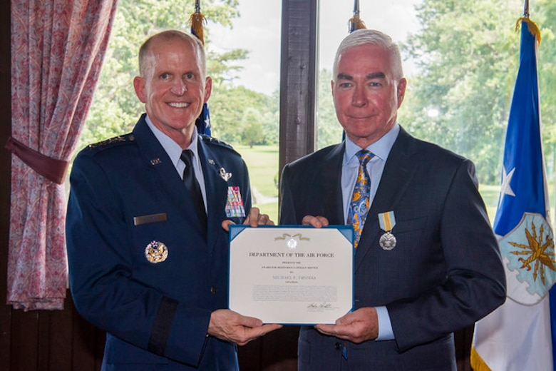 Air Force Vice Chief of Staff Gen. Stephen W. Wilson presides over a retirement ceremony in honor of Mike Thomas, the Joint Base Andrews golf course general manager, at JB Andrews, Md., July 12, 2019. (U.S. Air Force photo by Adrian Cadiz)