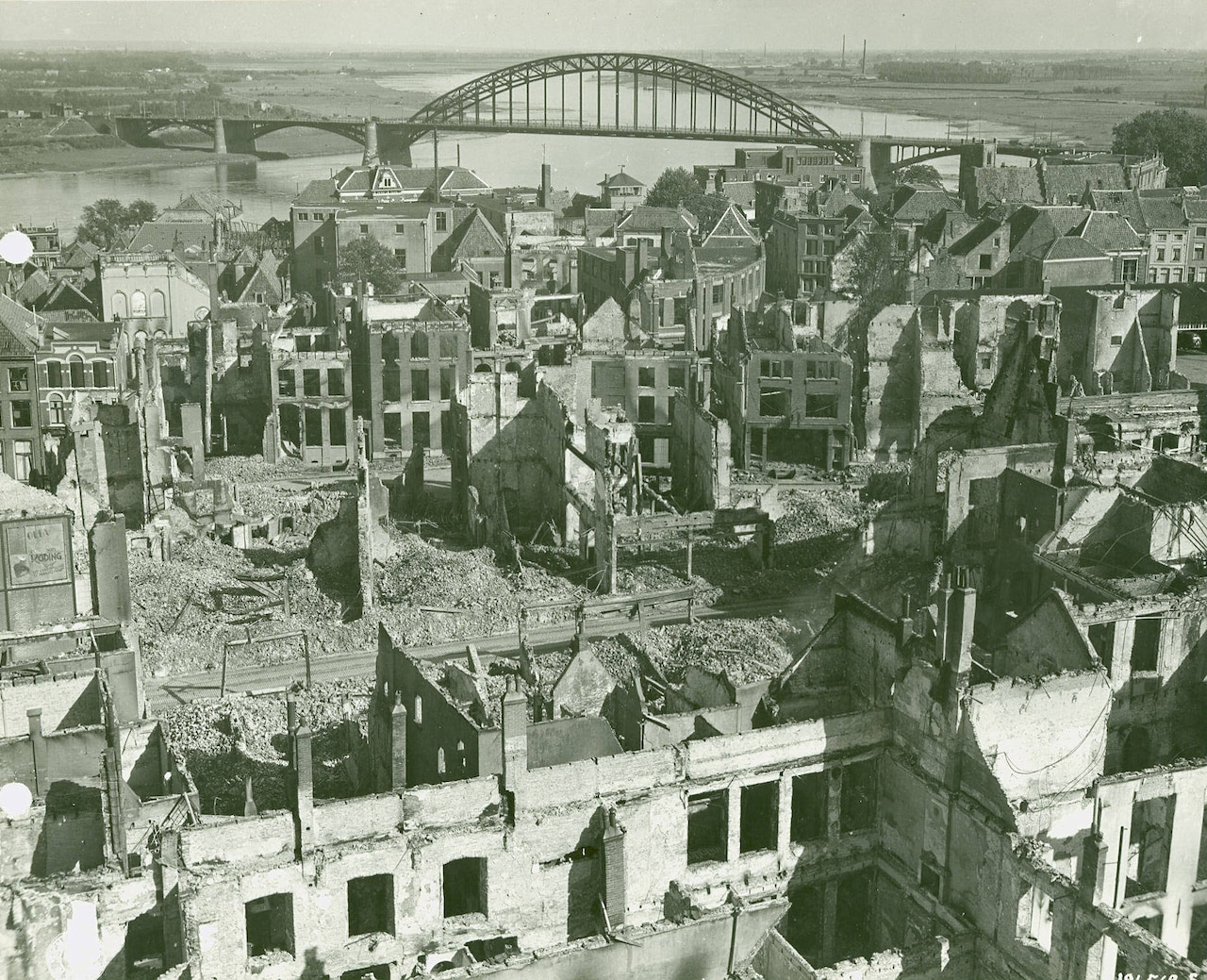 An aerial view of a town in which many of the buildings have been destroyed.
