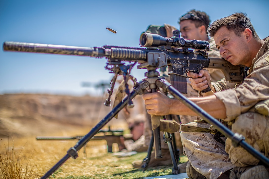 A U.S. Marine with the Maritime Raid Force, 11th Marine Expeditionary Unit, sights in on an M110 Semi-Automatic Sniper System during a live-fire sniper range at the King Abdullah II Special Operations Training Center. Eager Lion, U.S. Central Command's largest and most complex exercise, is an opportunity to integrate forces in a multilateral environment, operate in realistic terrain and strengthen military-to-military relationships.