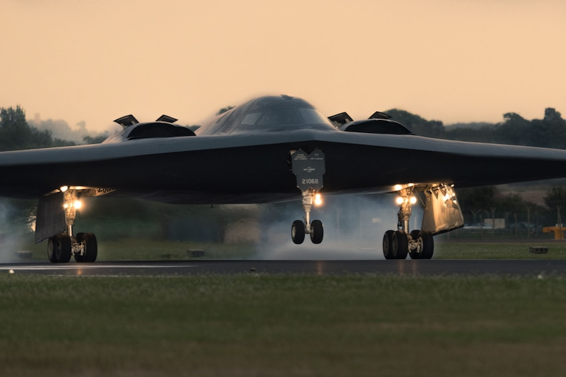 A military plane touches the ground during takeoff and landing training.