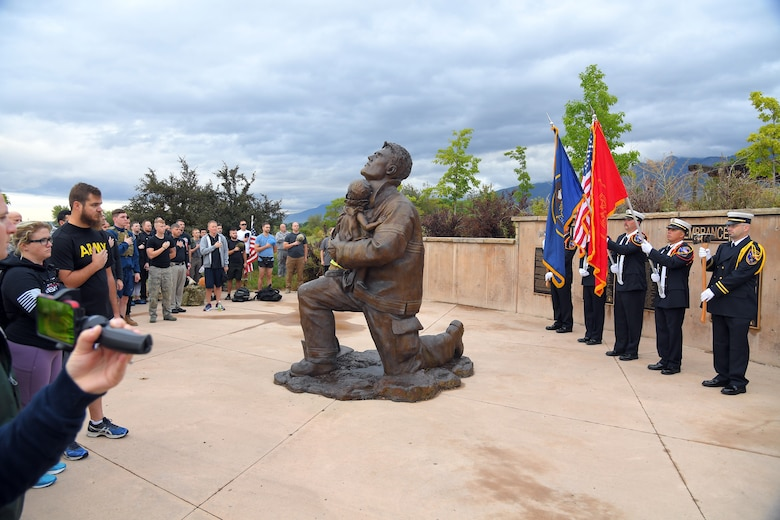 Participants salute the colors during the opening ceremony for the 9/11 Memorial Ruck March, at the Utah State University Botanical Gardens in Kaysville, Utah, Sept. 11, 2019. The event was co-sponsored by Hill Air Force Base first responders and fire and police departments from Kaysville and Layton, to honor and remember the fallen from the events of Sept. 11, 2001. (U.S. Air Force photo by Todd Cromar)