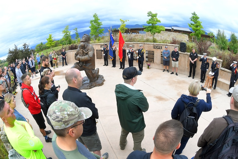 Participants listen to the ringing of the bell, during the opening ceremony of the 9/11 Memorial Ruck March, at the Utah State University Botanical Gardens in Kaysville, Utah, Sept. 11, 2019. The event was co-sponsored by Hill Air Force Base first responders and fire and police departments from Kaysville and Layton, to honor and remember the fallen from the events of Sept. 11, 2001. (U.S. Air Force photo by Todd Cromar)