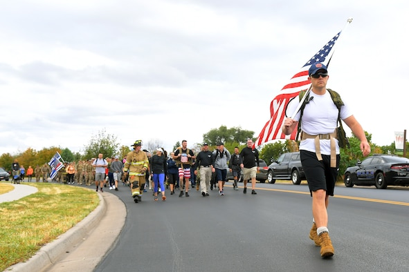 First Lt. John Gandy, Air Force Life Cycle Management Center, leads participants during the 9/11 Memorial Ruck March, in Kaysville, Utah, Sept. 11, 2019. The event was co-sponsored by Hill Air Force Base first responders and fire and police departments from Kaysville and Layton, to honor and remember the fallen from the events of Sept. 11, 2001. (U.S. Air Force photo by Todd Cromar)