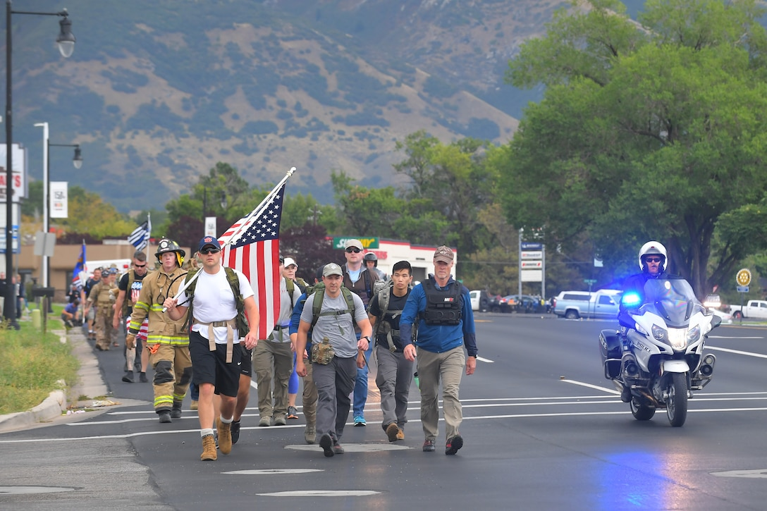 Participants walked 9.11 miles, some with 30-pound packs or firefighter gear during 9/11 Memorial Ruck March, in Kaysville, Utah, Sept. 11, 2019. The event was co-sponsored by Hill Air Force Base first responders and fire and police departments from Kaysville and Layton, to honor and remember the fallen from the events of Sept. 11, 2001. (U.S. Air Force photo by Todd Cromar)