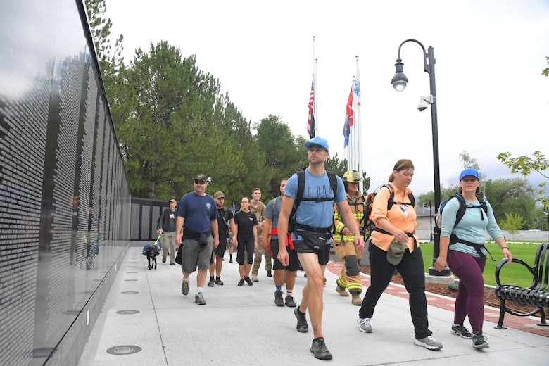 9/11 Memorial Ruck March participants, stride past the Vietnam War Memorial in Layton, Utah, Sept. 11, 2019. The Ruck March event was co-sponsored by Hill Air Force Base first responders and fire and police departments from Kaysville and Layton, to honor and remember the fallen from the events of Sept. 11, 2001. (U.S. Air Force photo by Todd Cromar)