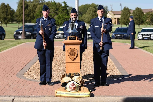 Firemen assigned to the 22nd Civil Engineering Squadron, ring the last alarm during the Patriot Day Ceremony Sept. 11, 2019, at McConnell Air Force Base, Kan. The last alarm honors firefighters that lost their lives on 9/11, it is represented by a bell that is rung three times, signifying the end of their final alarm. (U.S. Air Force photo by Airman 1st Class Alexi Bosarge)