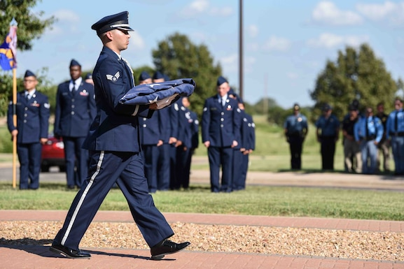 Senior Airman Griffin Rogers, 22nd Force Support Squadron honor guardsman, carries the flag after retreat Sept. 11, 2019, at McConnell Air Force Base, Kan. The Patriot Day Ceremony was held to honor the lives lost during the 9/11 attacks on the World Trade Center. A total of 576 emergency first responders passed away that day, trying to protect the lives of others. (U.S. Air Force photo by Airman 1st Class Alexi Bosarge)
