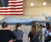 Members of the Military Affairs Committee visited Airmen at Creech Air Force Base, Nevada. August 28, 2019. During their tour, the members visited Airmen around base at the flight simulators, MQ-9 Reaper display and mission brief. (U.S. Air Force photo by Senior Airman Haley Stevens)