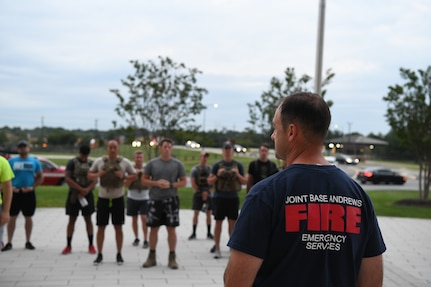 U.S. Air Force Lt. Col. Daniel C. Werner, 11th Civil Engineer Squadron commander, leads opening remarks at the stair climb event on Joint Base Andrews, Md., Sept. 9, 2019. Participants climbed up and down stairs on base to commemorate the number of stairs first responders had to climb in the World Trade Center towers during the 9/11 attacks in 2001. (U.S. Air Force photo by Airman 1st Class Spencer J. Slocum)