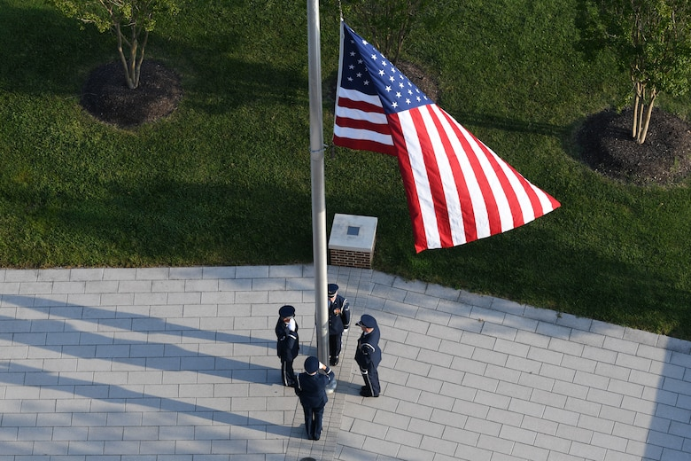 Members of the U.S. Air Force Honor Guard lower the flag to half-staff during the 9/11 memorial ceremony on Joint Base Andrews, Md., Sept. 11, 2019. Nearly 3,000 people lost their lives in the terrorist attack on Sept. 11, 2001 (U.S. Air Force photo by A1C Spencer J. Slocum)