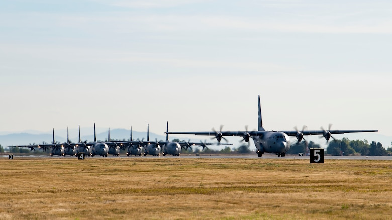 Mulitple U.S. Air Force, Joint and Coalition C-130Js and KC-130Js prepare to take off during exercise Mobility Guardian 2019 at Fairchild Air Force Base, Washington, Sept. 12, 2019. More than 4,000 personnel participated in or observed exercise Mobility Guardian, including Total Force Airmen, Joint, Combat Air Forces, and International Partners. (U.S. Air Force photo by Airman 1st Class Lawrence Sena)