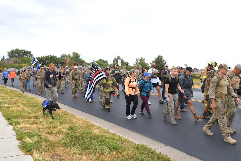 Participants begin their walk of 9.11 miles, some with 30-pound packs or firefighter gear, during 9/11 Memorial Ruck March, in Kaysville, Utah, Sept. 11, 2019. The event was co-sponsored by Hill Air Force Base first responders and fire and police departments from Kaysville and Layton, to honor and remember the fallen from the events of Sept. 11, 2001. (U.S. Air Force photo by Todd Cromar)