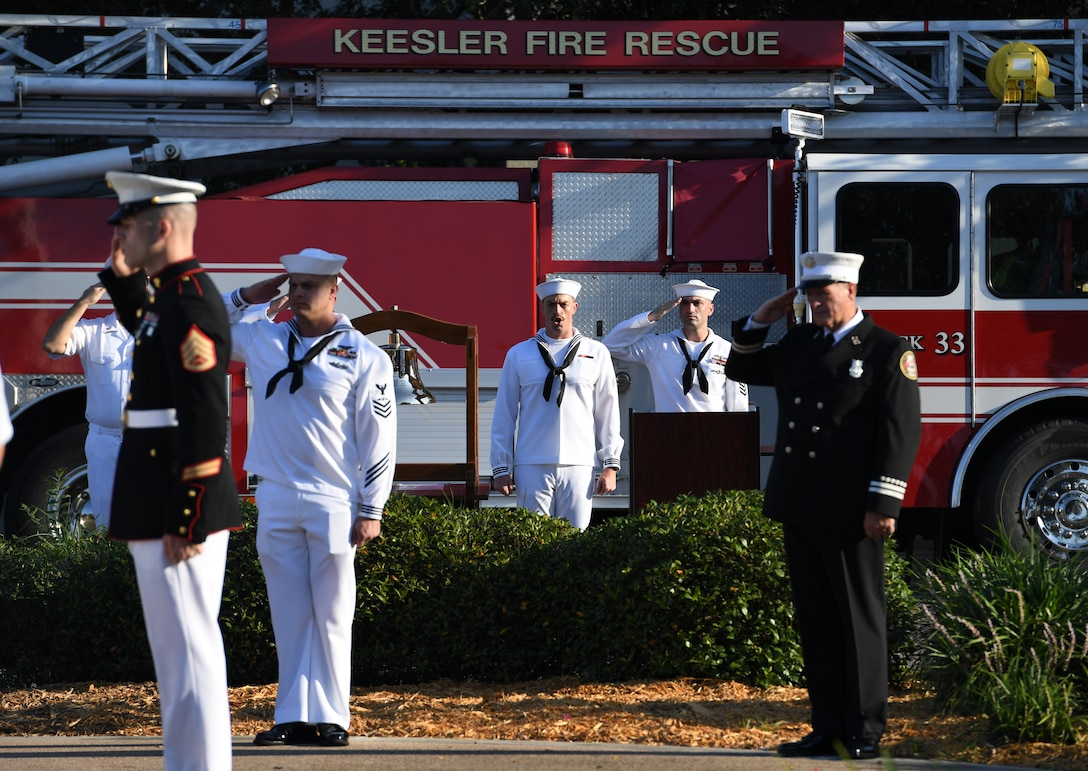 U.S. Navy Airman Apprentice James Greer, Center for Naval Aviation Technical Training Unit Keesler student, sings the national anthem during a 9/11 memorial ceremony hosted by CNATTU Keesler in front of the 81st Training Wing headquarters building on Keesler Air Force Base, Mississippi, Sept. 11, 2019. The event honored those who lost their lives during the 9/11 attacks. (U.S. Air Force photo by Kemberly Groue)