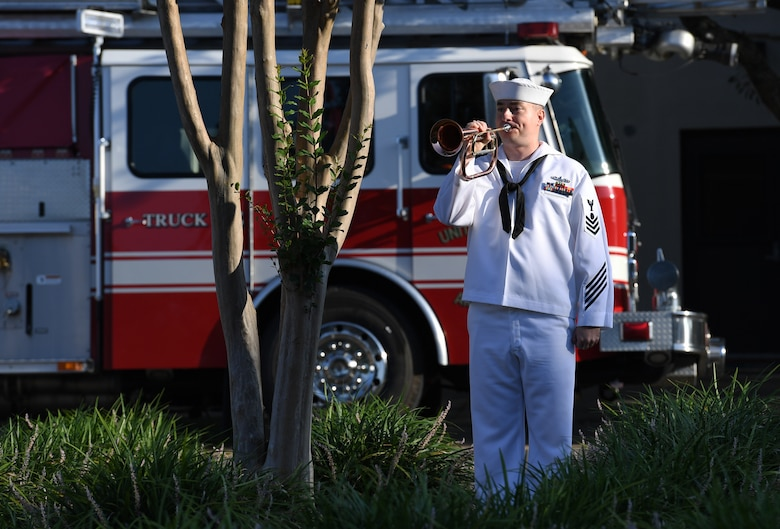 U.S. Navy Electricians Mate 1st Class Roger Rheault, Center for Naval Aviation Technical Training Unit Keesler instructor, plays taps during a 9/11 memorial ceremony hosted by CNATTU Keesler in front of the 81st Training Wing headquarters building on Keesler Air Force Base, Mississippi, Sept. 11, 2019. The event honored those who lost their lives during the 9/11 attacks. (U.S. Air Force photo by Kemberly Groue)