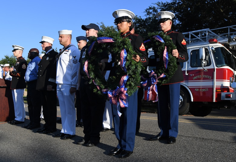 Keesler Airmen, Sailors and Marines participate in a 9/11 memorial ceremony hosted by the Center for Naval Aviation Technical Training Unit Keesler in front of the 81st Training Wing headquarters building on Keesler Air Force Base, Mississippi, Sept. 11, 2019. The event honored those who lost their lives during the 9/11 attacks. (U.S. Air Force photo by Kemberly Groue)