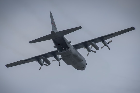 Photo of a C-130H Hercules taking off with the back open during the Cleveland Air Show.