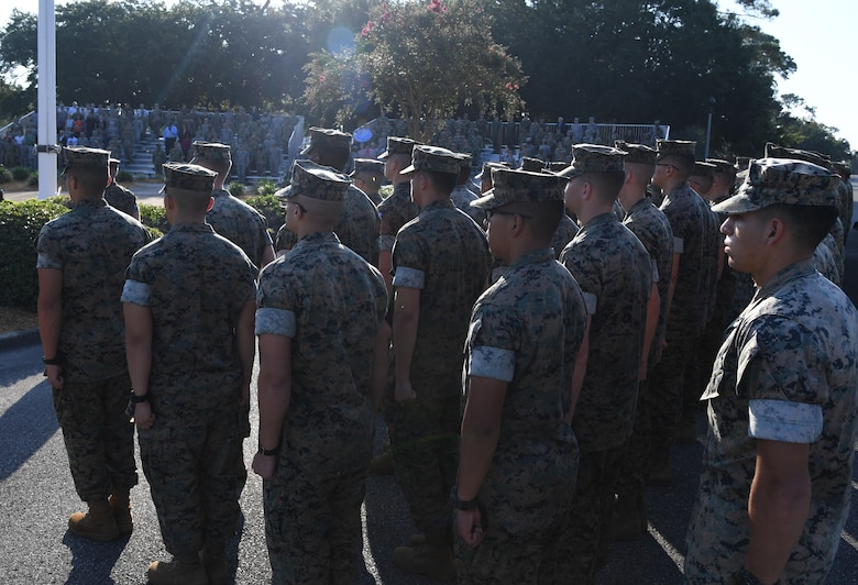 Members of the Keesler Marine Detachment stand in formation during a 9/11 memorial ceremony hosted by the Center for Naval Aviation Technical Training Unit Keesler in front of the 81st Training Wing headquarters building on Keesler Air Force Base, Mississippi, Sept. 11, 2019. The event honored those who lost their lives during the 9/11 attacks. (U.S. Air Force photo by Kemberly Groue)