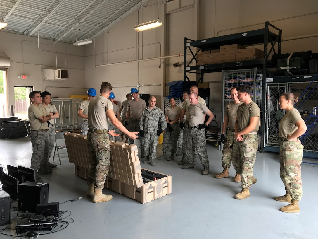 Staff Sgt. Joshua-James Patrick, 2nd Combat Weather Systems Squadron instructor, shows Airmen from the 25th Operational Weather Squadron the mast for a Portable Doppler Radar (PDR) system as part of a Deployed Weather Systems Training class Aug. 20, 2019, at Hurlburt Field, Florida. The PDR is used by the Air Force at established and austere locations worldwide to provide real time weather radar. (U.S. Air Force photo by Tech. Sgt. Andrew Meier)
