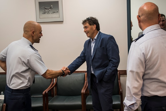 Photo of military member shaking hands with U.S. Representative from Ohio