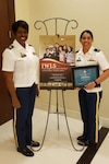 1st Lt. Danielle Nuszkowski, executive officer from A company, 249th Engineer Battalion (right), stands with Lt. Col. Letitia Bryant, 8th Theater Sustainment Command Equal Opportunity Officer after receiving her Joint women's Leadership Symposium Meritorious Service Award during the JWLS August 21-23.