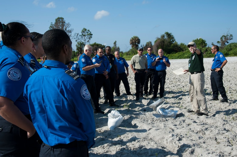 Local Transportation Security Administration officers observe the after effects of explosive ordnance on the bomb range, Sept. 11, 2019, at MacDill Air Force Base, Fla.  The 6th Civil Engineer Explosive Ordnance Disposal Flight hosted an annual training for the TSA officers, to demonstrate the effects of explosive devices. (U.S. Air Force photo by Airman 1st Class Shannon Bowman)
