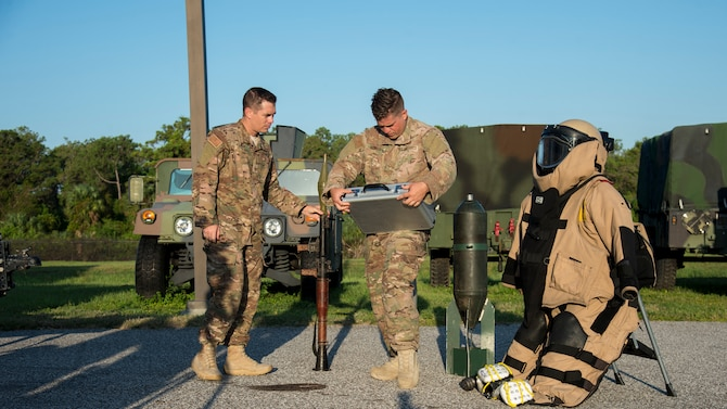 U.S. Air Force Master Sgt. Ryan Oliver, the 6th Civil Engineer Squadron Explosive Ordnance Disposal Flight section chief, and Staff Sgt. Jordan Oswald, a 6th CES/ EOD technician, set up a visual aid display, Sept. 11, 2019, at MacDill Air Force Base, Fla.  The 6th EOD Flight hosted an annual explosives training for local Transportation Security Administration officers at MacDill. (U.S. Air Force photo by Airman 1st Class Shannon Bowman)