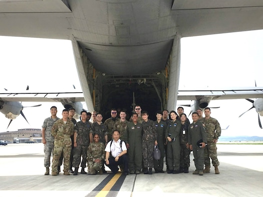 U.S. Air Force, Republic of Korea Air Force and civilian participants pose for a group photo during the inaugural Joint Combined ROK-U.S. Aeromedical Evacuation Subject Matter Expert Exchange at Osan Air Base, South Korea, Aug. 28, 2019. The goal of this SMEE was to build trust and enhance interoperability to support the mission of ROK-U.S. Combined Force Command by understanding and synchronizing both parties' aeromedical evacuation capabilities. (Courtesy)
