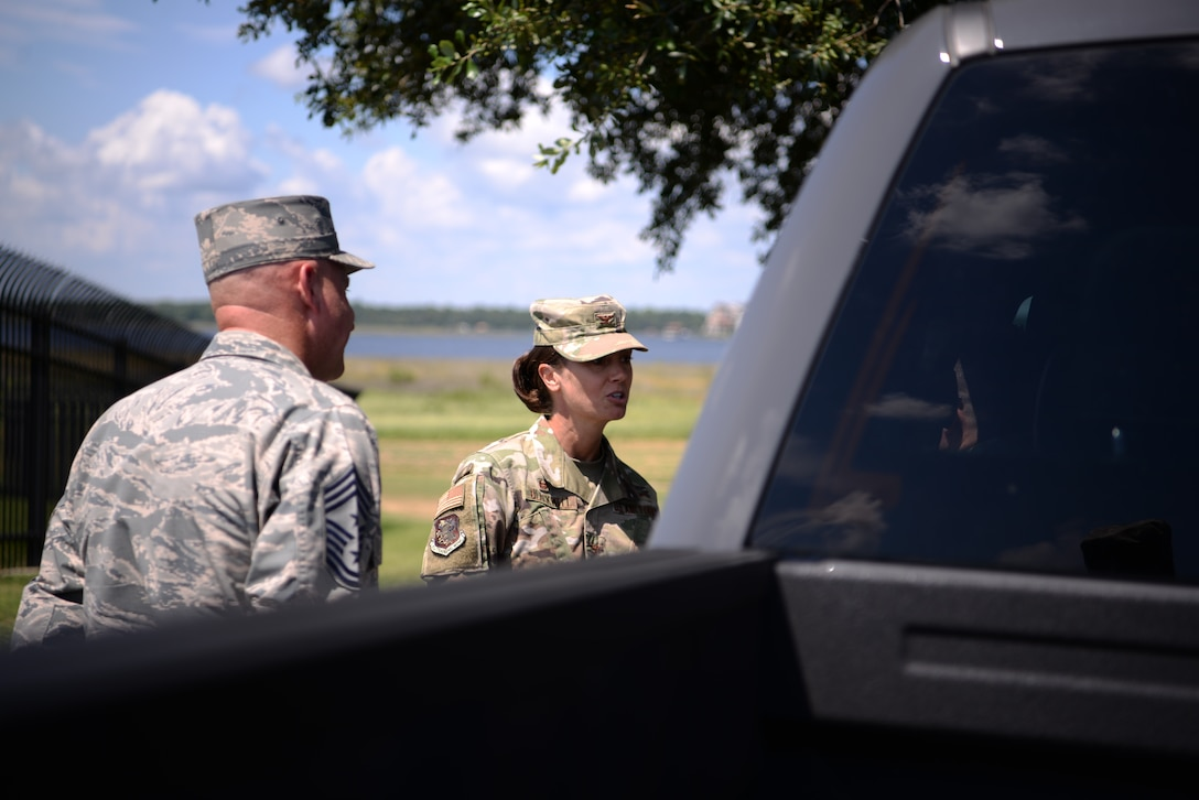 U.S Air Force Col. Heather Blackwell, 81st Training Wing commander, and Chief Master Sgt. David Pizzuto, 81st TRW command chief, address an individual pulled over for speeding in base housing on Keesler Air Force Base, Mississippi, September 10, 2019. The 81st Security Forces Squadron has recently started making efforts to crackdown on base speeding amidst concerns brought up during the Keesler Housing Forum. (U.S Air Force photo by Airman 1st Class Spencer Tobler)