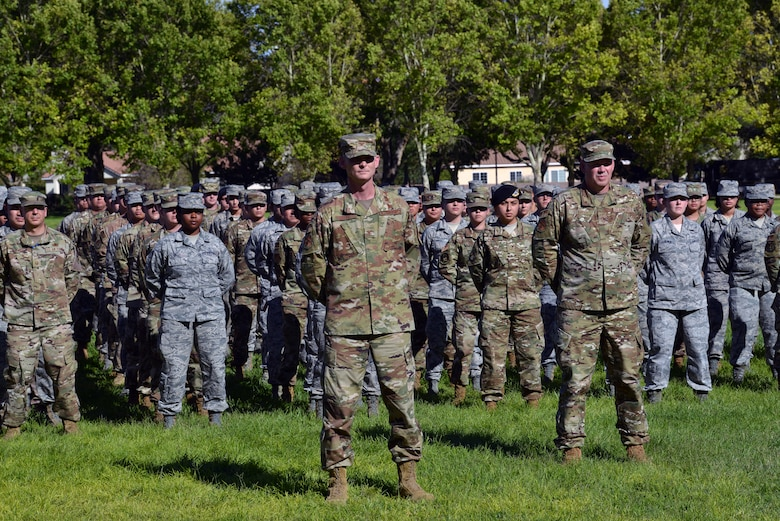 U.S. Air Force Col. David S. Miller, 377th Air Base Wing commander, stands in front of a Team Kirtland formation during a 9/11 retreat ceremony at Kirtland Air Force Base, N.M., Sept. 11, 2019. The retreat ceremony was held to honor and remember the nearly 3,000 people that died in the attacks on 9/11 and for those that have been killed in defense of the country since that day. (U.S. Air Force photo by Staff Sgt. Dylan Nuckolls/Released)