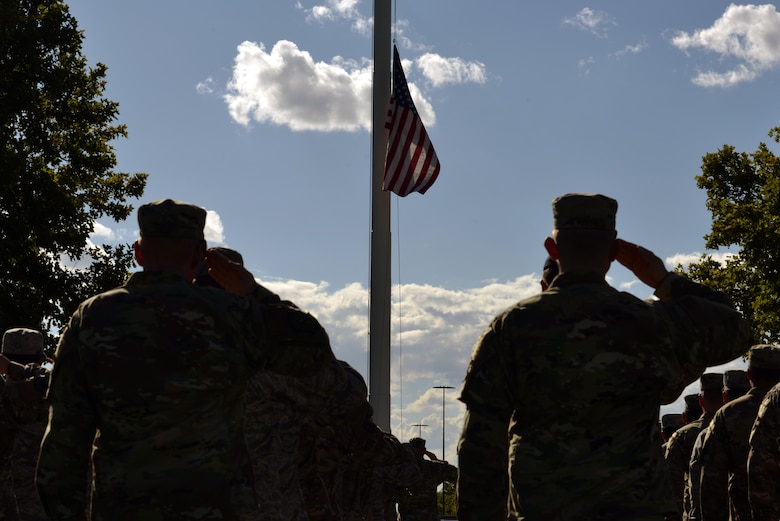 Airmen salute during a 9/11 retreat ceremony at Kirtland Air Force Base, N.M., Sept. 11, 2019. The retreat ceremony was held to honor and remember the nearly 3,000 people that died in the attacks on 9/11 and for those that have been killed in defense of the country since that day. (U.S. Air Force photo by Staff Sgt. Dylan Nuckolls/Released)