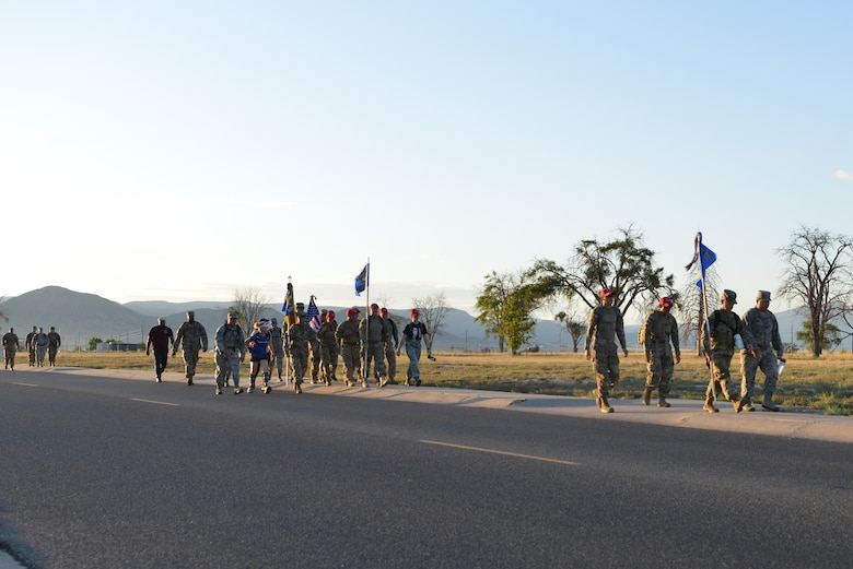 Members of Team Kirtland participate in a 9/11 memorial ruck march at Kirtland Air Force Base, N.M., Sept. 11, 2019. More than 50 members participated in the four-mile ruck march held to honor and remember the nearly 3,000 people that died in the attacks on 9/11 and for those that have been killed in defense of the country since that day. (U.S. Air Force photo by Staff Sgt. Dylan Nuckolls/Released)
