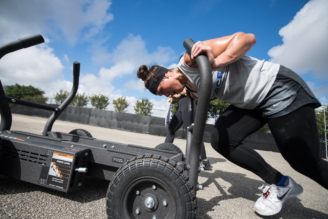 2nd Lt. MaryCaitlin Dominguez pushes a sled during the 2019 Air Force Alpha Warrior Final Battle at Retama Park, Selma, Texas, Sept. 12, 2019. Air Force, Army and Navy military athletes competed against each other to determine the top three men and three women for each service. Those athletes make up the service teams that will go against each other during the 2019 Inter-Service Battle Sept. 14 at Retama. The Air Force partnered with Alpha Warrior three years ago to deliver functional fitness training to Airmen and their families. (U.S. Air Force photo by Sarayuth Pinthong)