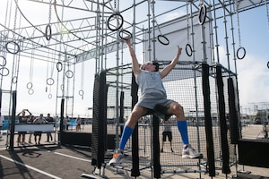 Capt. Noah Palicia attacks the rings on the Alpha Warrior Proving Ground , Selma, Texas, Sept. 9, 2019 during the Air Force Alpha Warrior Final Battle. The annual competition crowns the Air Force's top Alpha Warriors with the top three men and three women forming the Air Force Alpha Warrior Team.  The Air Force partnered with Alpha Warrior three years ago to deliver functional fitness training to Airmen and their families. (U.S. Air Force photo by Sarayuth Pinthong)