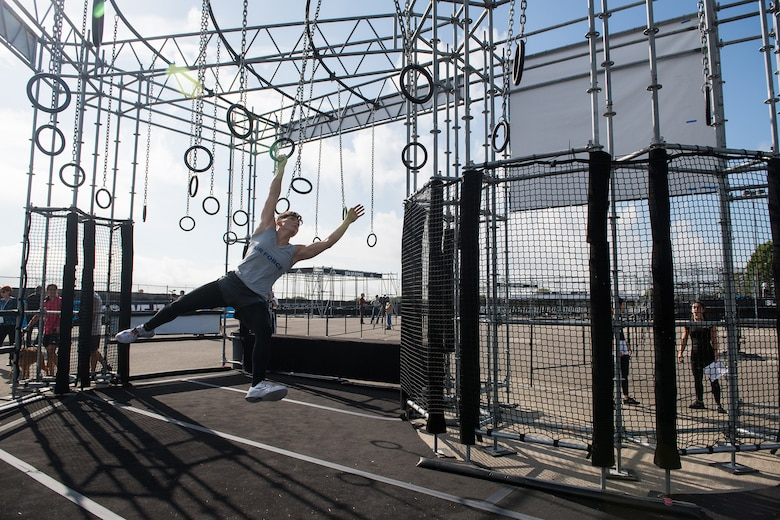 2nd Lt. Michelle Strickland takes to the rings during the 2019 Air Force Alpha Warrior Final Battle at Retama Park, Selma, Texas, Sept. 12, 2019. Air Force, Army and Navy military athletes competed against each other to determine the top three men and three women for each service. Those athletes make up the service teams that will go against each other during the 2019 Inter-Service Battle Sept. 14 at Retama. The Air Force partnered with Alpha Warrior three years ago to deliver functional fitness training to Airmen and their families. (U.S. Air Force photo by Sarayuth Pinthong)