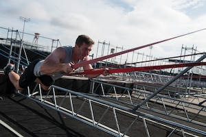 2nd Lt. Jesse Montgomery takes on an obstacle during the 2019 Air Force Alpha Warrior Final Battle at Retama Park, Selma, Texas, Sept. 12, 2019. Air Force, Army and Navy military athletes competed against each other to determine the top three men and three women for each service. Those athletes make up the service teams that will go against each other during the 2019 Inter-Service Battle Sept. 14 at Retama. The Air Force partnered with Alpha Warrior three years ago to deliver functional fitness training to Airmen and their families. (U.S. Air Force photo by Sarayuth Pinthong)