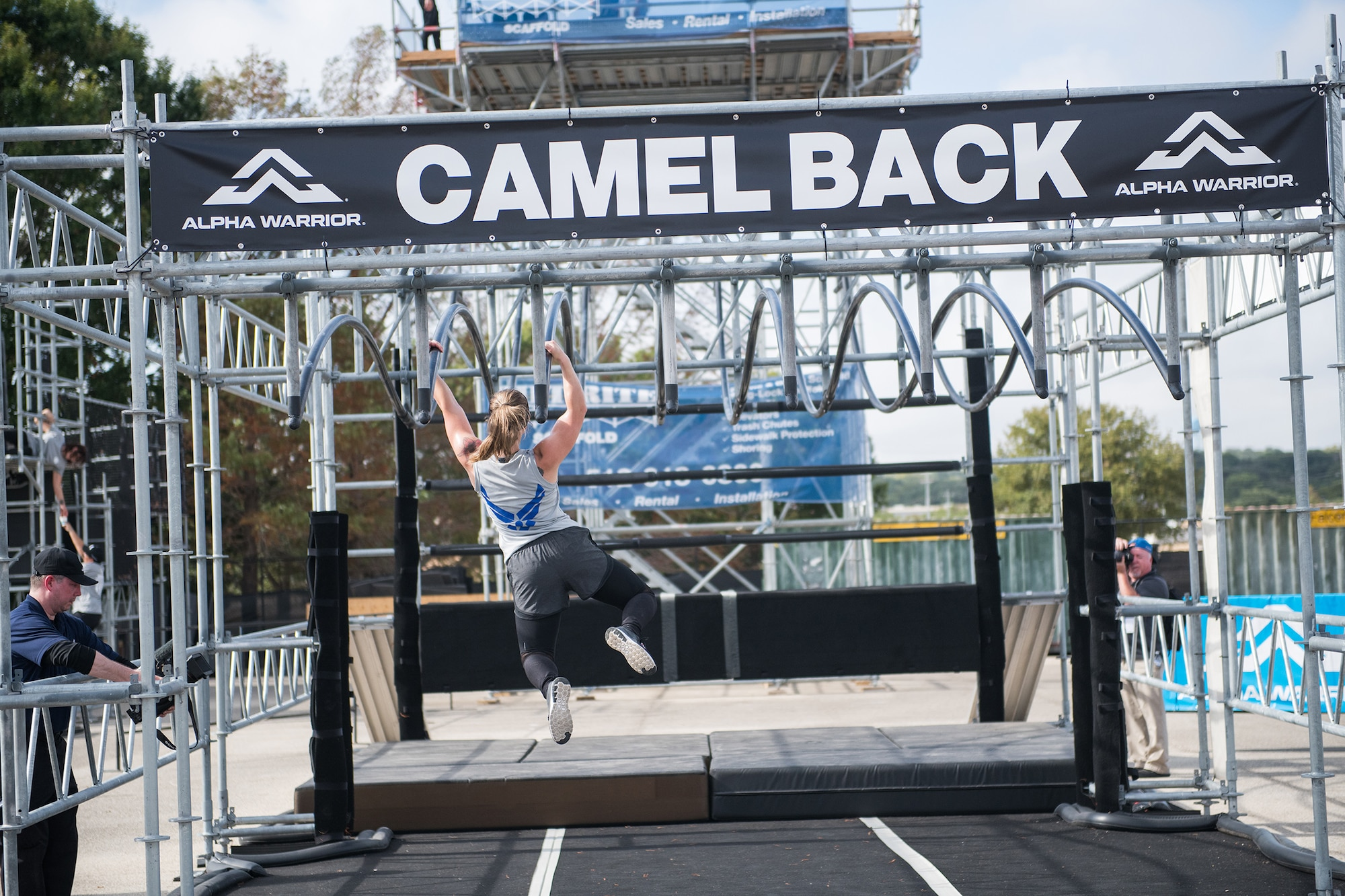 Staff Sgt. Tiffanie Sawatzke takes on the camel back obstacle during the 2019 Air Force Alpha Warrior Final Battle at Retama Park, Selma, Texas, Sept. 12, 2019. Air Force, Army and Navy military athletes competed against each other to determine the top three men and three women for each service. Those athletes make up the service teams that will go against each other during the 2019 Inter-Service Battle Sept. 14 at Retama. The Air Force partnered with Alpha Warrior three years ago to deliver functional fitness training to Airmen and their families. (U.S. Air Force photo by Sarayuth Pinthong)