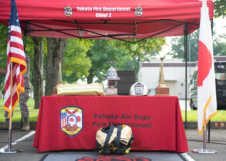 A ceremonial bell is displayed next to firefighting gear during the 9/11 Tower Run, Sept. 11, 2019 at Yokota Air Base, Japan.