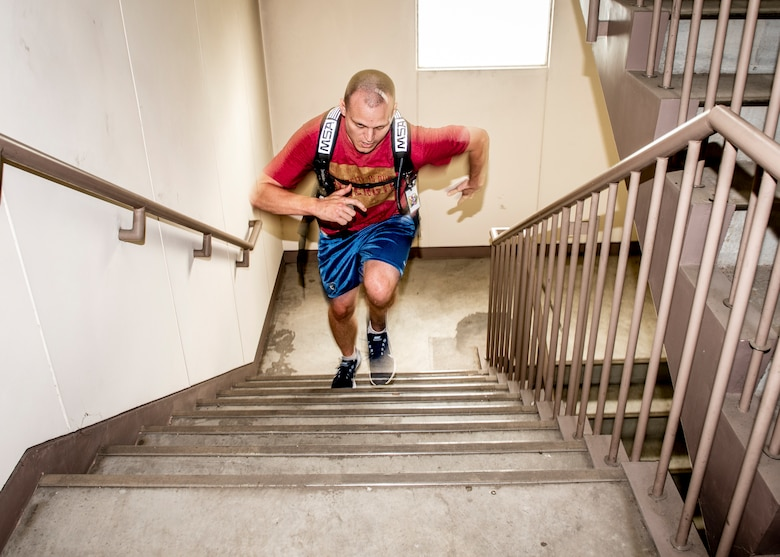 Master Sgt. Arthur Scruggs, 374th Operations Support Squadron 1st sergeant, runs up a flight of stairs during the 9/11 Tower Run, Sept. 11, 2019 at Yokota Air Base, Japan.
