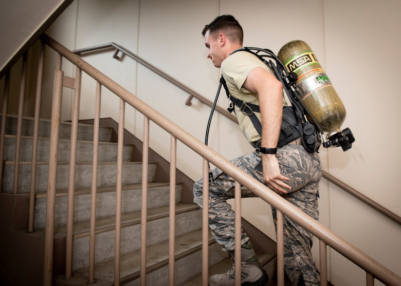 Staff Sgt. Dylan Meek, 374th Civil Engineer Squadron NCO in charge of logistics, runs up a flight of stairs during the 9/11 Tower Run, Sept. 11, 2019 at Yokota Air Base, Japan.