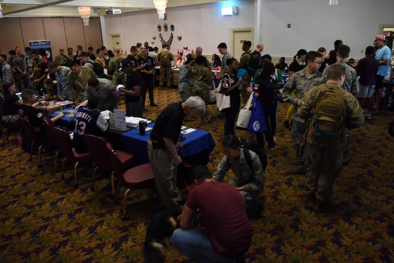U.S. Air Force and Republic of Korea Air Force members check out different organizations at the Airmen 4 Airmen Club Fair during the Resilience Tactical Pause capstone event at Kunsan Air Base, Republic of Korea, Sept. 13, 2019. The event featured clubs for individuals looking to volunteer, develop professionally and join social organizations. (U.S. Air Force photo by Staff Sgt. Joshua Edwards)