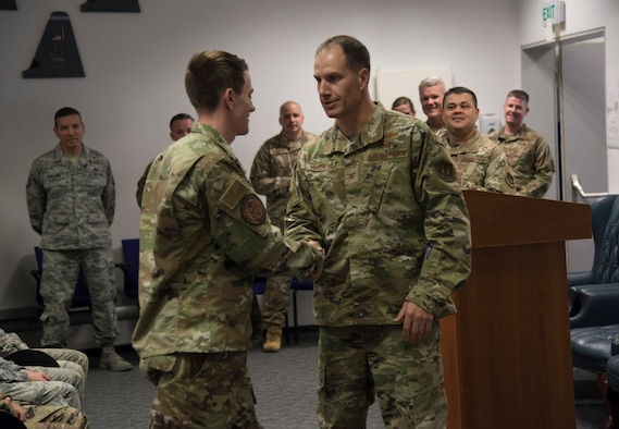 U.S. Air Force Col. Matthew S. Husemann, 86th Airlift Wing vice commander, congratulates Staff Sgt. Spencer Koepp, a C-130 aircraft maintenance craftsman with the 86th Aircraft Maintenance Squadron, on being named Airlifter of the Week at Ramstein Air Base, Germany, Sept. 12, 2019.
