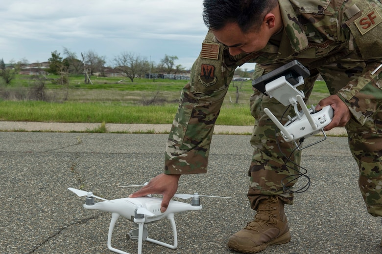 U.S. Air Force Staff Sgt. Staff Sgt. Francis Arnaldo, 9th Security Forces Squadron resource protection NCO in charge, prepares a drone while testing out the Hivemapper program capabilities at Beale Air Force Base, California, April 12, 2019. Beale members have partnered with the Hivemapper team since late 2018, to utilize the program as a way to same time, money, and manpower, while improving defense capabilities. (U.S. Air Force photo by Tech. Sgt. Veronica Montes)