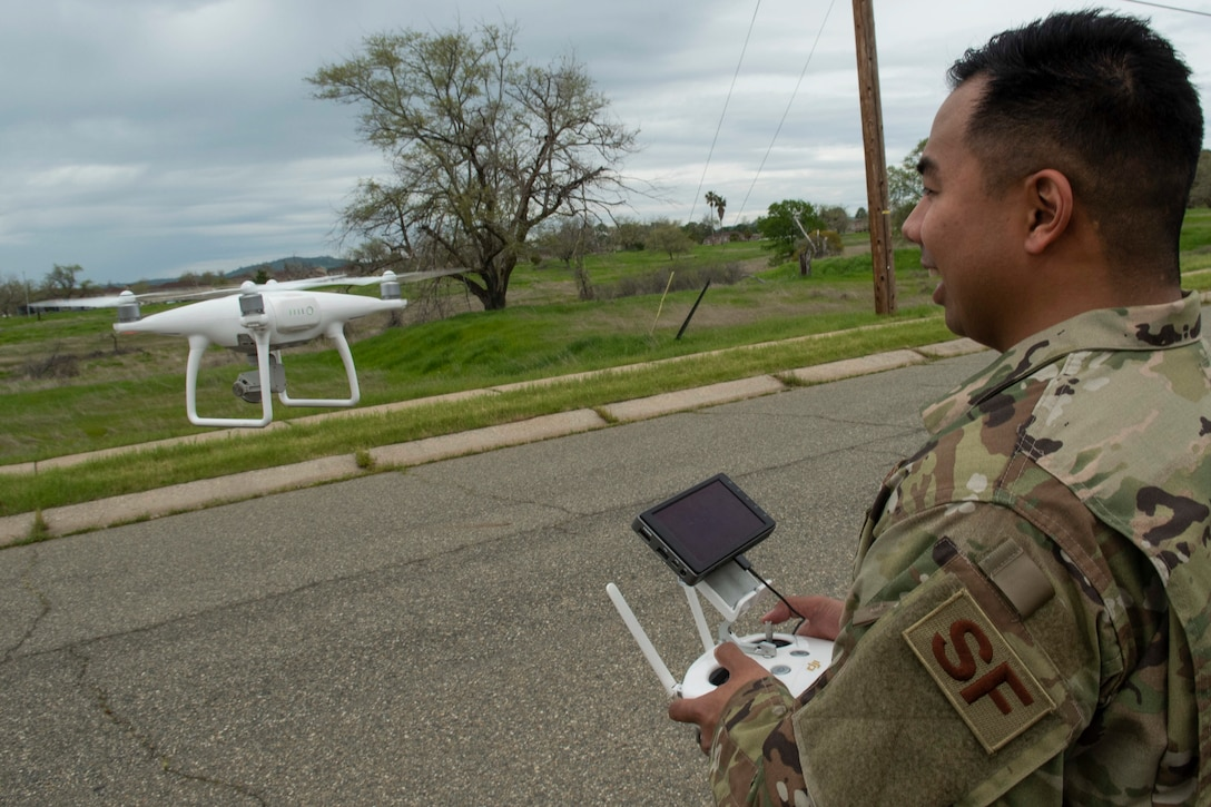 U.S. Air Force Staff Sgt. Francis Arnaldo, 9th Security Forces Squadron resource protection NCO in charge, flies a drone while testing out the Hivemapper program capabilities at Beale Air Force Base, California, April 12, 2019. The Hivemapper program is a three-dimensional drone that can map infrastructure while providing visualization and analytic tools. (U.S. Air Force photo by Tech. Sgt. Veronica Montes)