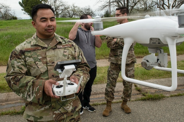 U.S. Air Force Staff Sgt. Francis Arnaldo, 9th Security Forces Squadron resource protection NCO in charge, flies a drone while testing out the Hivemapper program capabilities at Beale Air Force Base, California, April 12, 2019. Beale is currently the first base to beta-test the Hivemapper program, a drone capability that records and senses change detection. (U.S. Air Force photo by Tech. Sgt. Veronica Montes)