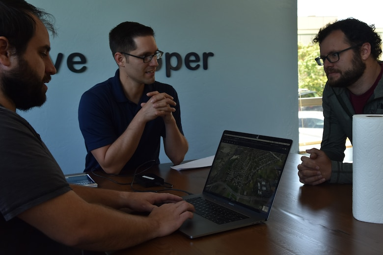 Will Urbina, Hivemapper head of flight operations, meets with Master Sgt. Nathaniel May, 9th Intelligence Squadron operations superintendent, and Dane Perry, Hivemapper product head, at the software company in San Francisco, California, June 4, 2019. Beale members have been partnering with the Hivemapper team since late 2018, to utilize the program as a way to same time, money, and manpower, while improving security capabilities.  (U.S. Air Force photo by Tech. Sgt. Veronica Montes)